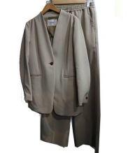 AMIW(アミウ)の古着「ジャージーセットアップスーツ」|カーキ
