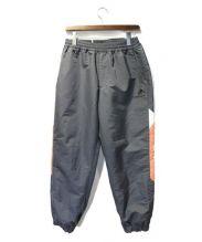 FLAGSTUFF(フラッグスタッフ)の古着「18AW TRACK PANTS」 グレー×オレンジ