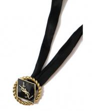 YVES SAINT LAURENT(イヴサンローラン)の古着「シルクリボンロゴネックレス」|ゴールド