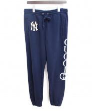 GUCCI(グッチ)の古着「ヤンキースパッチ付きコットン ジョギングパンツ」|ネイビー